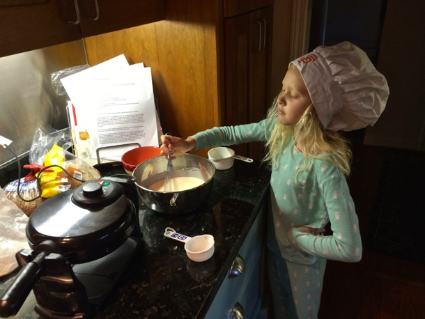 Grace helping cook breakfast