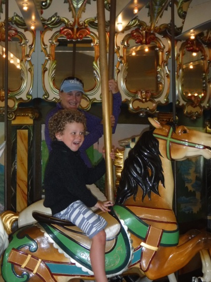 James on first up and down carousel ride