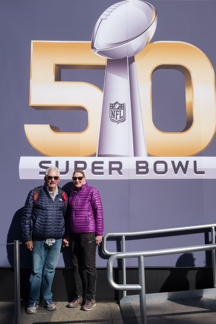 D and L in front of Super Bowl 50 sign