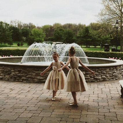 Kyleigh and Grace in front of fountain