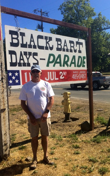 D in front of Black Bart parade sign