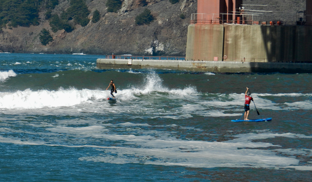 paddle-boarders-surfing-1