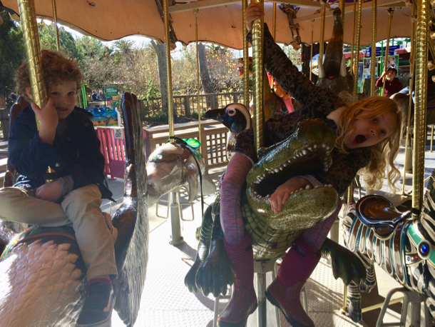 grace-and-james-on-merry-go-round-1