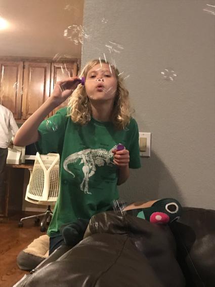Grace blows bubbles - 1
