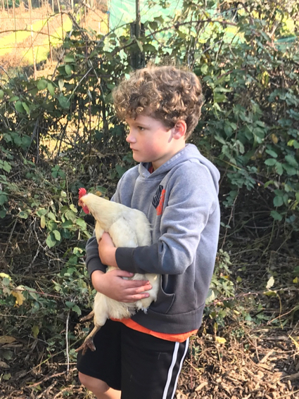 james holds chicken - 1